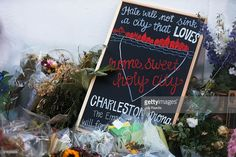 A sign is seen at a memorial in front of the Emanuel African Methodist Episcopal Church after a mass shooting at the church killed nine people, on June 22, 2015. 21-year-old Dylann Roof is suspected of killing nine people during a prayer meeting in the church in Charleston, which is one of the nation's oldest black churches.