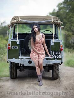 Wellie boot wearing Country girl on an old Landrover