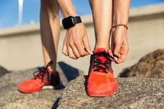 Close up of a male runner tying his shoelaces photo by vadymvdrobot on Envato Elements Fitbit Models, Physical Fitness Program, Workout Regimen, Wearable Technology, Female Photographers, You Fitness, Workout Programs, Close Up, Benefit