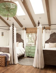 Flowing bedcurtains and custom headboards create a whimsical mood in Gracie and Cecilia's room.
