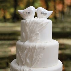 Black and white square wedding cake with the bride and groom's initials and porcelain love birds.