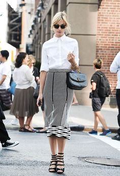 NEW YORK, NY - SEPTEMBER 07:  Actress Caitlin Fitzgerald is seen outside the Thakoon show wearing a Thakoon skirt on September 7, 2014 in New York Cit...
