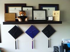 - hang grad hats underneath all earned awards, diplomas and degrees. hang grad hats underneath all earned awards, diplomas and degrees. Diploma Display, Award Display, Diploma Frame, Display Ideas, Display Wall, Feng Shui Habitacion, College Diploma, Bedroom Decor, Wall Decor