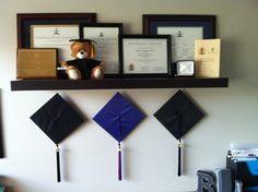 hang grad hats underneath all earned awards, diplomas and degrees.