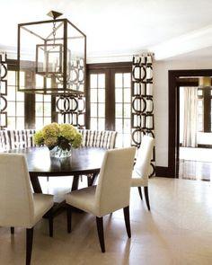 Espresso-colored furniture, dark woodwork, oversize Holly Hunt lantern, Victoria Hagan drapery fabric