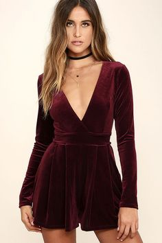 You'll be a gift to any gathering in the Decorated in Love Burgundy Velvet Romper! Luxurious stretch velvet shapes a surplice bodice with a banded waist that ties at back. Long sleeves and relaxed shorts complete this flirty look! Hidden back zipper.