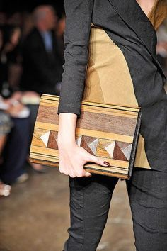 I don't know if this is a book or a portfolio or what she's carrying, but I've been wanting to make a bag to carry my laptop, and I love this design idea. Could do it out of leather scraps or something.