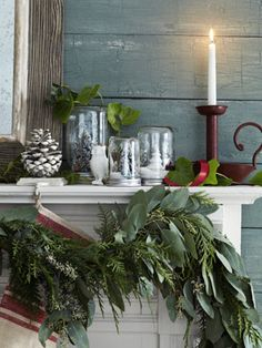 Woodland Christmas Decor - Ellis H has your owls, garlands and bell jars to make this gorgeous rustic mantel!