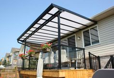We like the light filter aspect of this Acrylic Patio Cover.... thought it could be used as a car port.  We like the wrapped posts and crossbeam to make it look more finished.