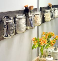 Organize your small bathroom items with this creative mason jar craft.