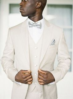 You really can't go wrong with a cream groom's suit in the summer. It's classic, cool and finding neckwear to match is a breeze!