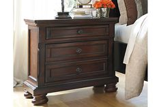 The quality craftsmanship is clear to see. The classic design elements—including antiqued hardware and bun feet—are easy to love. Satisfying your taste for traditional furnishings, the Porter nightstand is elegant, without looking fussy. Two drawers—one large, one small—keep bedside odds and ends within easy reach.