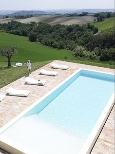 Swimming pool among rolling hills. Incredible landscape.
