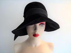 Lilly Dache Womens Black Hat Vintage 1960s Cloche Wide Brim Wool Felt Dachette  $65  https://www.rubylane.com/item/676693-A16-123/Lilly-Dache-Womens-Black-Hat-Vintage?search=1