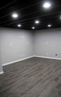 Our Painted Basement Ceiling An example of a painted basement ceiling with photos. Why we chose this option, how we did it and if we would do it again. Black Ceiling, Open Basement, Basement Colors, Black Basement Ceiling, Home Remodeling, Basement Living Rooms, Basement Gym, Basement Decor