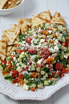 This chic and delicious Middle Eastern Chickpea Salad from CookingInStilettos.com is packed with protein-packed chickpeas and fresh veggies tossed in a lemon basil vinaigrette. This easy salad can be served as a side dish, main entree or even nestled in pita bread for the perfect lunch on the go | @CookInStilettos Easy Recipe | Vegetarian | Salad | Chickpea | Barefoot Contessa