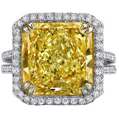 8.94 Carat GIA Cert Yellow Diamond Platinum Ring   From a unique collection of vintage engagement rings at https://www.1stdibs.com/jewelry/rings/engagement-rings/