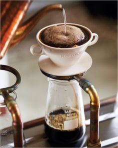 Beautiful picture of pour over coffee being made. - Lifted from a friend's Pinterest board.