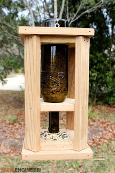 Wine Bottle Bird Feeder -- I have a couple people this would make a great gift for!