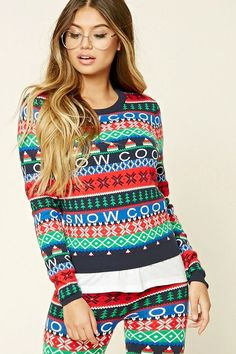 """A lightweight knit sweater featuring a Fair Isle pattern with an allover """"Snow Cool"""" graphic, a round neckline, long sleeves, and ribbed trim. [Promotional Pin]"""