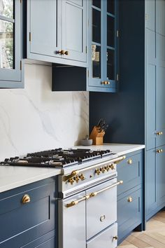 Dark blue painted kitchen cabinets + brass hardware + french range + cup pulls i., blue painted kitchen cabinets + brass hardware + french range + cup pulls in the kitchen Dark Blue Kitchen Cabinets, Painting Kitchen Cabinets, Dark Blue Kitchens, Soapstone Kitchen, Kitchen Countertops, Hague Blue Kitchen, Blue Shaker Kitchen, Navy Cabinets, Hickory Kitchen
