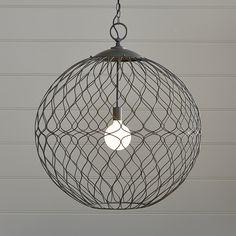 Shop Hoyne Brass Pendant.  Sized to impress, the large Hoyne pendant lamp crisscrosses in an open-weave of sculptural geometry.  Its iron wire sphere is hand-welded and finished in brass for an warm, artisanal look.