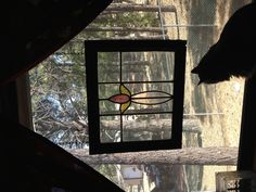 Stained glass window hanging in a window!