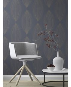 This Sparkling Glitter Linear Leaf Wallpaper features interwoven silver glitter strands in an abstract pattern on a lightly textured blue background. Free UK delivery available