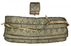 Late-Ottoman 'silahlık' (weapons belt), 19th century, worn throughout the Ottoman Empire, made from layers of leather, each with scalloped edges and containing slips to hold a yatağan sword and other weapons.