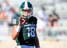 Sep 27, 2014; East Lansing, MI, USA; Michigan State Spartans quarterback Connor Cook (18) gestures from the field prior to the game against the Wyoming Cowboys at Spartan Stadium. Mandatory Credit: Mike Carter-USA TODAY Sports