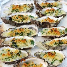 Oysters Rockefeller Recipe Appetizers with butter, garlic cloves, bread crumbs, shallots, fresh spinach, pernod, salt, pepper, olive oil, grated Gruyère cheese, chopped parsley, shells, oysters, rock salt, hot sauce, lemon wedges
