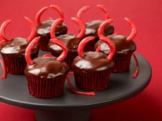 These devilish dark cupcakes with a bittersweet chocolatey glaze make a perfectly sinful snack.