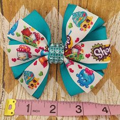 Check out this item in my Etsy shop https://www.etsy.com/listing/277839638/shopkins-pinwheel-hair-bow-4-wide