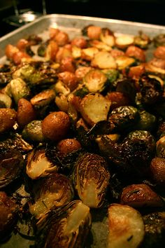 Roasted Brussels Sprouts and Baby Red Potatoes  I took liberties with this recipe. Added thyme, used kosher salt, added 2 more cloves of garlic. We were cooking some chicken at the same time so the temp was variable. I ate this till it came out my ears.