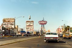Las Vegas Strip, 1983 - Photo courtesy of Henk Binnendijk. The Frontier sign, shown here in front of their race & sports book, is now in the collection at the Neon Museum. Las Vegas Strip, Old Vegas, California Love, Las Vegas Nevada, Traveling By Yourself, History, Vintage, Slipper, Historia