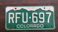 Colorado License Plate RFU697 1993 Registration Stickers #AmericanAntique #CoLicensePlate #RFU697 #GreenAndWhite #LicensePlate #VintageColoPlate #VintageCoPlate #VintageColorado #RockyMountains #ColoradoPlate