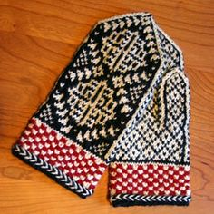 These are the mittens I'm currently kniting. They're tough! And I think my yarn is a little thick because they're HUGE, even after removing 20 stitches and ending them early!  http://twostrands.wordpress.com/2008/09/11/chrysanthemum-mittens-the-pattern/