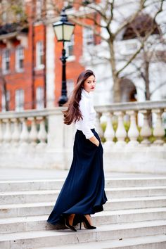 This is a look made famous by Carolina Herrera. The white shirt, maxi skirt, heavy gold jewellery and red lip, represent glamour of the most grown up kind. The woman speaks through the clothes, not the other way round.
