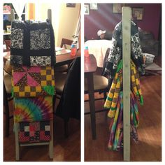 Quilts my mom has made for me over the years hung on and old antique wooden ladder