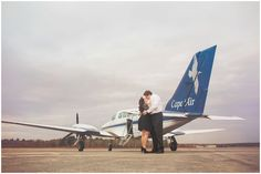 Engagement photo on the airport runway with airplane photographed by Massart Photography, a Rhode Island newborn, family and wedding photographer.