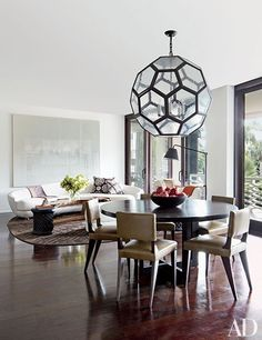 Statement-making chandeliers make these stylish spaces shine