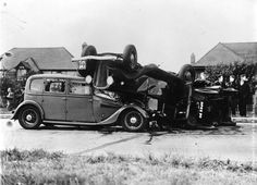 A three car crash on the Kingston By-Pass, two of the cars are overturned. (Photo by J. A. Hampton/Topical Press Agency/Getty Images). 15th July 1939.