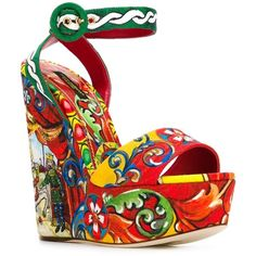 Dolce & Gabbana Carretto Siciliano print sandals ($1,435) ❤ liked on Polyvore featuring shoes, sandals, high wedge sandals, multi color sandals, ankle strap sandals, multi colored sandals and colorful sandals