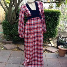 """1960s Vintage Navy & Red Plaid Maxi Dress 1960's vintage maxi dress. Beautiful woven plaid fabric in a red, white, and navy blue. Fitted bodice with a navy velveteen bust line panel. Square cut neck line. Empire waist with navy velveteen ties for a great fit. Long puffy poet sleeves with elastic gathers at the cuff. Long slim skirt, floor length, with gathers in the front at the hip. Metal zipper up the back. No tags. Excellent condition! Perfect for holiday parties! Bust 36"""", waist 30"""" max…"""