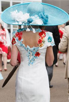 A racegoer shows up to Ladies Day at Royal Ascot wearing one of the larger blue hats we saw on the afternoon.