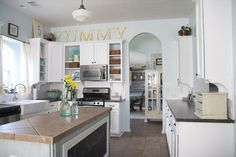 beadboard backboard, painted black fridge, aqua highlights, open cupboards, white cabinets, farmhouse sink to die for!!,