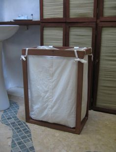 Well, we finally got our laundry situation *ironed out*. I made a small redwood frame after a design Melissa saw on some home supply websi...