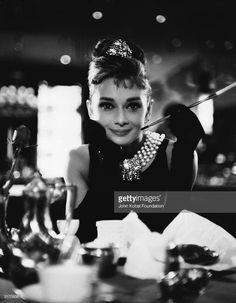 Audrey Hepburn (1929 - 1993) wields a cigarette holder in her role as the charming gold-digger Holly Golightly in 'Breakfast at Tiffany's', directed by Blake Edwards.