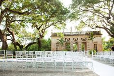 "Clear chairs wedding ceremony. Professional Wedding Photos Miami, Florida Vizcaya Museum and Garden Wedding, Photos by PS Photography, Claire Pettibone dress ""Midnight,"" Navy Blue, Slate Blue Tuxes, Vintage Chic Gatsby Style Wedding in April, Ryan and Jordan Nettleship, details on SkinnyGirlStandard Blog"