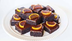 Dessert doesn't have to be intimidating or complicated! These super easy chocolate orange cake bars are made with orange marmalade and topped with a simple c. Cake Bars, Dessert Bars, Dessert Recipes, Easy Desserts, Chocolate Orange Cheesecake, Chocolate Ganache, Tatyana's Everyday Food, Citrus Cake, Sheet Cake Recipes